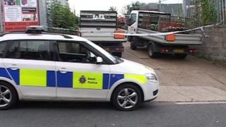 Police car outside Adams Gas and Leisure