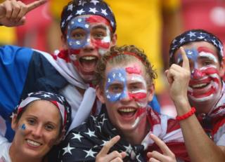 United States fans cheer in the rain prior to the 2014 FIFA World Cup Brazil group G match between the United States and Germany