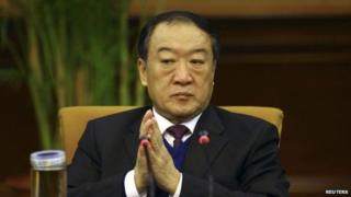 """Then Communist Party Secretary of Jiangxi province, Su Rong attends a group discussion during the National People""""s Congress in Beijing March 6, 2012."""
