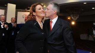 A report by Standards Commissioner Douglas Bain into allegations about the conduct of First Minister Peter Robinson and his wife Iris has been delayed