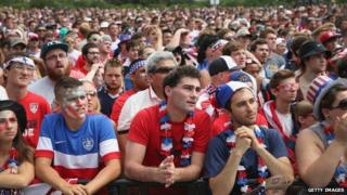 Fans watch USA play Germany in a World Cup soccer match on one of two large screens placed for fans in Grant Park in Chicago, Illinois 26 June 2014