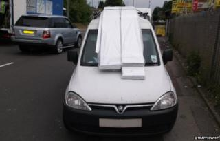 The Vauxhall Combo van with its windscreen obscured
