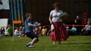 Young competitor in the Egg Throwing Championships in Swaton