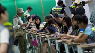 People vote at polling centre for an unofficial referendum on democratic reform in Hong Kong on June 29, 2014 in Hong Kong, Hong Kong.