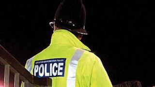 Police officer at night