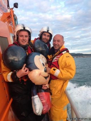 Dun Laoghaire RNLI crew with Mickey Mouse balloon they rescued from the Irish Sea