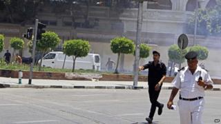 Egyptian security forces inspect the scene after two bombs went off near the presidential palace in Cairo, Egypt