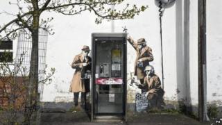 Banksy's Spy Booth artwork in Cheltenham