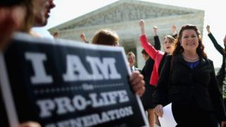 Pro-life protestors celebrate the Hobby Lobby decision outside the Supreme Court on 30 June, 2014