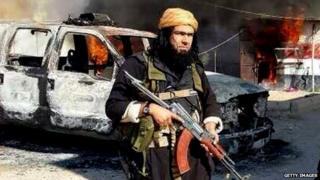 A gun-toting Isis militant