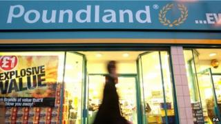 A man walks past a Poundland store