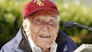 Louis Zamperini gestures during a news conference, in Pasadena, California 9 May 2014