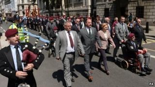 Stewart McLaughlin (pushing wheelchair), son of Corporal Stewart McLaughlin who was killed during the Falklands War leads a march of former Paras and Falkland veterans through Whitehall to Downing Street in London