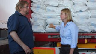 Justine Greening and a Mercy Corps member
