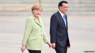 German Chancellor Angela Merkel is welcomed by Chinese Premier Li Keqiang
