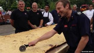 Firefighters show off their naan bread