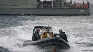 Australian navy personnel transfer asylum-seekers to Indonesian rescue boat near Panaitan island, West Java (31 August 2012)