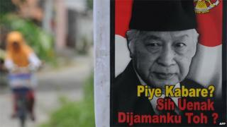 A poster bearing the portrait of Suharto with a slogan 'How are you bro? Still better in my time, no?' is displayed in Karanganyar town in central Java, March 9, 2014
