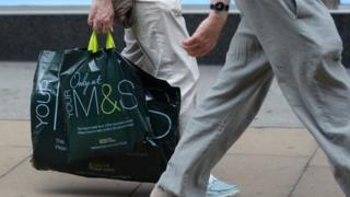 Person carrying M&S bag
