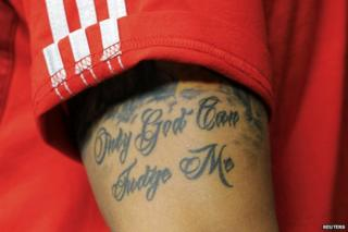 """Mesut Ozil's tattoo reads """"Only God can judge me"""""""