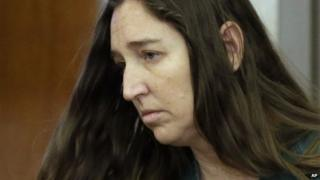 Megan Huntsman, who is accused of killing six of her babies and storing their bodies in her garage, appears in court, in Provo, Utah 28 April 2014