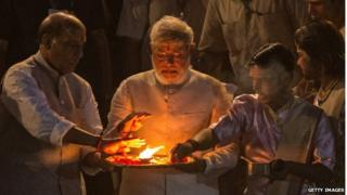 Prime minister, Modi, praying over a flame after election victory