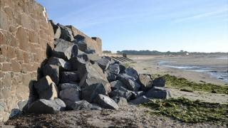 Temporary repairs to the sea wall breach at Vazon, Guernsey