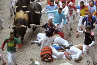 Runners chased during fourth bull run at San Fermin festival in Pamplona (10 July)