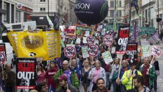 Several hundred workers take part in a rally in central London, July 2014
