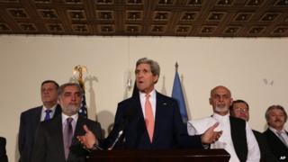 US Secretary of State John Kerry flanked by Abdullah Abdullah and Ashraf Ghani - 12 July