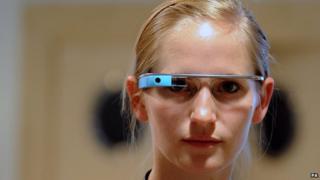 A woman wearing a Google Glass computer