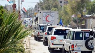 Red Crescent Society delivering shipment of UN food aid to Moaddamiet al-Sham area on outskirts of Damascus. 14 July 2014