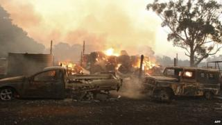 A file photo taken on 7 February 2009 shows vehicles burning near Labertouche, some 125km west of Melbourne