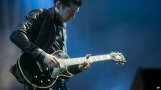 Arctic Monkeys guitarist Alex Turner on stage in Hungary in July 2014