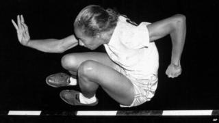 "Alice Coachman winning in the running high jump in the Women""s National Track Meet in Grand Rapids, Iowa, in 1948"