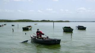 A fisherman rows his boat in Guantanamo Bay in June 2014