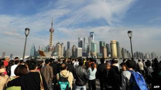 People looking at Pudong financial district in Shanghai
