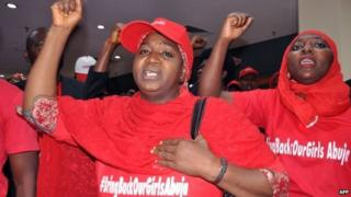 Women wearing t-shirts reading #Bringbackourgirls chant slogans in Abuja on 14 July 2014