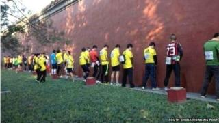 Runners in the 2013 Bejing Marathon seen urinating on the walls of the Forbidden City (file)