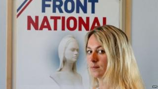 Anne-Sophie Leclere posing in front of National Front poster - 16 July