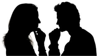 A man and a woman in silhouette