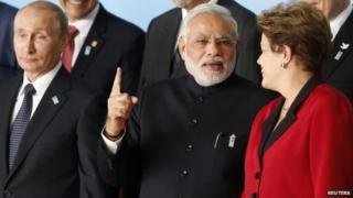PM Narendra Modi (C) with Russian President Vladimir Putin and Brazil's President Dilma Rousseff (R) at the 6th BRICS summit in Brasilia July 16, 2014