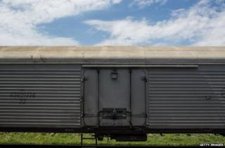 A freight wagon carrying the remains of MH17 victims in Torez station, eastern Ukraine, 20 July