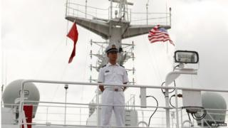 A guard keeps media out of a restricted area as they tour the Peoples Liberation Army Naval Hospital ship Peace Ark at Joint Base Pearl Harbor Hickam in Honolulu, Hawaii, on 5 July 2014.