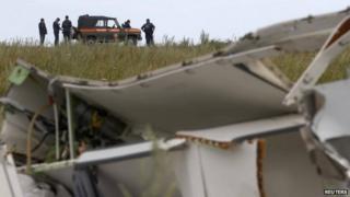 Ukrainian officials at the MH17 crash site