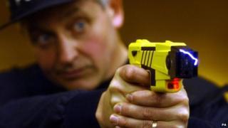 Police officer firing Taser