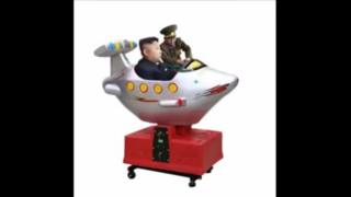 "A screengrab from the ""Fat guy Number 3"" video showing Kim Jong-un in a small fairground airplane"