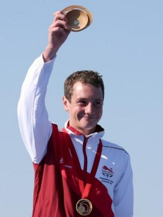 Gold medallist Alistair Brownlee holds up his quaich