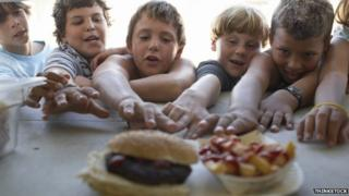 Picture of children reaching for food