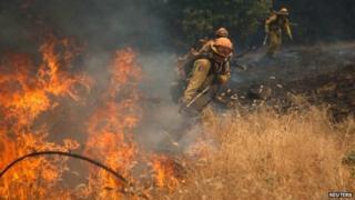 Fire fighters battle a spot fire near Plymouth, California (26 July 2014)
